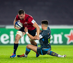 Jack O'Donoghue of Munster  is tackled by Tiaan Thomas-Wheeler of Ospreys<br /> <br /> Photographer Simon King/Replay Images<br /> <br /> European Rugby Champions Cup Round 1 - Ospreys v Munster - Saturday 16th November 2019 - Liberty Stadium - Swansea<br /> <br /> World Copyright © Replay Images . All rights reserved. info@replayimages.co.uk - http://replayimages.co.uk