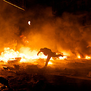 January 24, 2014 - Kiev, Ukraine: Anti-government protestors attack the Ukrainian riot police, outside the Dynamo Kiev stadium near the Independence Square. (Paulo Nunes dos Santos)