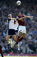 Photo: Olly Greenwood.<br />Arsenal v Tottenham Hotspur. The Barclays Premiership. 22/04/2006. Spurs' Michael Dawson and Arsenal's Robin Van Persie challenge for the header.