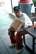 """Homeless man age 45 begging with sign """"please help hungry"""".  Washington DC USA"""