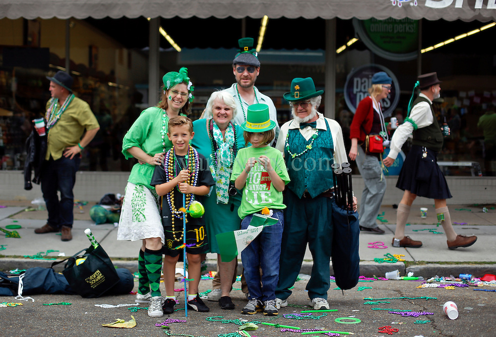 12 March 2016. New Orleans, Louisiana.<br /> Amy George-Hirons and family with Ben at the Irish Channel St Patrick's Day parade as the procession makes its way along Magazine Street.<br /> Photo©; Charlie Varley/varleypix.com