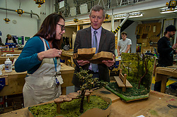 """Pictured: Willie Rennie is shown models of woodland furniture by Claire Thomson and Jonny Smitgh, Lecturers on furniture design and manufacture at Fife College.<br /><br />Scottish Liberal Democrat Leader Willie Rennie visited the Future Energy Skills centre at Fife College in Glenrothes today to argue for """"astronomical investment"""" in home insulation to tackle the climate emergency and end fuel poverty by 2025 . <br /><br /><br /><br />Ger Harley 