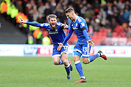 Cardiff City's  Anthony Pilkington ® celebrates with Aron Gunnarsson (l) after he scores his teams 3rd goal. . EFL Skybet championship match, Bristol City v Cardiff City at the Ashton Gate Stadium  in Bristol, Avon on Saturday 14th January 2017.<br /> pic by Carl Robertson, Andrew Orchard sports photography.