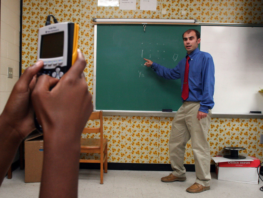 With a scientific calculator in hand, 7th grader, Shanice Davis, listens to instruction from J.V. Martin Junior High School Math teacher, Sebastian Chirila. Chirila, who is a Romania native, taught at J.V. Martin for only one year before having to quit due to his Visa expiring.