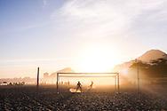 Shooting goals on Copacabana Beach at Sunset