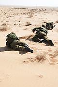 Female Israeli infantry soldiers training in the desert
