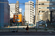 A school girl walks in a back street in Tsukiji, Tokyo, Japan. Wednesday February 5th 2020