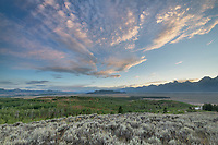 Clouds glowing in the evening sky above the Teton Range, Grand Teton National Park Wyoming