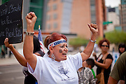 22 JULY 2010 -- PHOENIX, AZ: Nora Mendivill (CQ) leads a chant against 1070 in front of the courthouse. Hundreds of people came to the Sandra Day O'Connor United States Courthouse (CQ) in downtown Phoenix Thursday. PHOTO BY JACK KURTZ