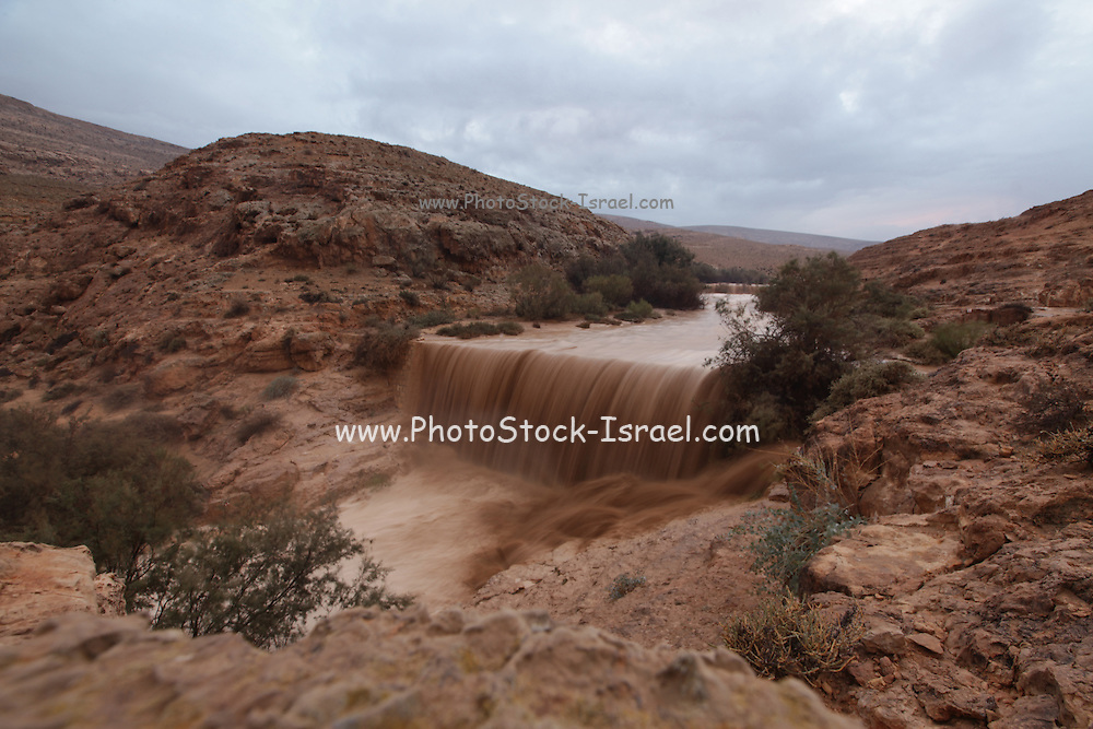 Flash flood in the desert. Mamshit River in the Ramon crater