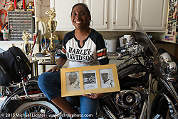 "Club member and past president Marlene Harris shows off some photos of her grandfather and father, Flying Eages MC founding members ""Big Buster"" and ""Little Buster"" in her home garage. The Flying Eagles MC (founded 1950). Baltimore, MD, USA. August 16, 2015.  Photography ©2015 Michael Lichter."
