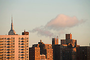 the Empire State building towering above residential high rise seen from down town Brooklyn