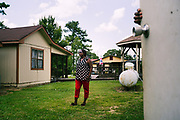 """LOWNDES COUNTY, AL – JULY 10, 2017: Perman Hardy, 58, stands in her backyard near the below ground septic tank installed as part of her home's construction in 1989. Hardy, a former home health nurse, has had trouble with her septic tank backing up into the house since her first year in the home, and says she's just learned to live with it. """"The first time it happened, we had to leave the house for two weeks because [sewage] was everywhere. It was in every room in the house.""""<br /> <br /> A recent study conducted by Baylor University suggests that nearly one 1 in 3 people in Lowndes County have hookworm, a parasite normally found in poor, developing countries. Below ground septic tanks are common in Lowndes, but due to the chalky clay soil throughout much of the Black Belt, septic tanks are prone to backing up into people's homes during heavy rains. With failing or absent municipal sewage systems in the county, many families choose to live with open, above ground sewer systems made from PVC pipe, which pump raw sewage into nearby streams or open land."""