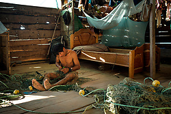 NO WEB/NO APPS - Exclusive. (Text available) A fisherman prepares his nets before a fishing trip, in 'Palma Real' native community, near Puerto Maldonado, Peru on July 17, 2017. The Amazon rainforest is famous as 'The Lung of the Earth', but also for the presence of numerous native communities, who have always lived isolated and in close contact with nature for generations, used to seek for food and medicines and to build items directly from the environment in which they live. The unstoppable rise of globalization has drastically changed their needs, expectations and consequently their way of life. Located in the Tambopata National Reserve, on the border between Peru and Bolivia, the native Comunidad Palma Real is one of the clearest examples of this change. Living on the banks of the Madre de Dios River since approximately 1976, Palma Real comprises about 300 people part of the nomadic community Ese-Eja, established in the Amazon rainforest of Peru before the Spanish colonization. Photo by Giacomo d'Orlando/ABACAPRESS.COM