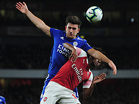 Football - 2018 / 2019 Premier League - Arsenal vs. Leicester City<br /> <br /> Harry Maguire of Leicester challenges Alex Iwobi, at The Emirates.<br /> <br /> COLORSPORT/ANDREW COWIE