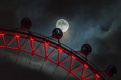 London, December 01 2017. Seen from Downing Street, the moon rises behind the London Eye. © Paul Davey