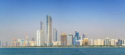 Skyline of modern skyscrapers along Corniche in Abu Dhabi United Arab Emirates