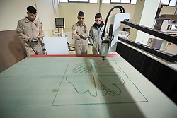 25 February 2020, Jerusalem: Carpentry student Emran Bukhari operates a CNC cutter to produce a version of the Lutheran World Federation logo. The Lutheran World Federation's vocational training centre in Beit Hanina offers vocational training for Palestinian youth across a range of different professions, providing them with the tools needed to improve their chances of finding work.