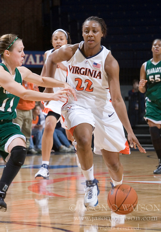 Virginia Cavaliers Guard Monica Wright (22) dribbles down court in action against Charlotte.  The Virginia Cavaliers women's basketball team defeated The University of North Carolina - Charlotte 49ers 74-72 in the 2nd round of the Women's NIT at John Paul Jones Arena in Charlottesville, VA on March 19, 2007.
