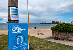 North Berwick, East Lothian, Scotland, United Kingdom, 20th July 2020. Campaign against Covid-19 carpark plan: East Lothian Council proposes a temporary 200 long-stay carpark on famous Elcho Green, West Beach; part of 'Spaces for People' to help people socially distance during the coronavirus pandemic & to compensate traders for loss of parking already removed in the narrow High Street where wands widen pavements. An online petition 'West Bay not a parking bay' to object to the destruction of the beauty spot, has collected nearly 4,000 signatures.  <br /> Sally Anderson | EdinburghElitemedia.co.uk