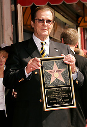 File Photo - Sir Roger Moore is honored with the 2,350th Star on The Hollywood Walk of Fame in Hollywood, CA, USA on October 11, 2007. Actor Sir Roger Moore, best known for playing James Bond, has died aged 89, his family has announced. He played the famous spy in seven Bond films including Live and Let Die and the Spy Who Loved Me. Photo by Walker/ABACAPRESS.COM