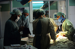 KABUL 16 August 2005..Maiwand Hospital, Plastic Surgery....Afghan Doctors are getting ready to operate Shabana.....Shabana. a nine months  old Afghan girl, has been diagnosed with a 'neurofibroma'. This is a tumor or growth located along a nerve or nervous tissue. It is an inherited disorder. If left unchecked, a neurofibroma can cause severe nerve damage leading to loss of function to the area stimulated by that nerve.....The Rehabilitative Surgery Unit (RSU) at Maiwand Hospital is fully supported by the French NGO Medical Refresher Courses for Afghans (MRCA), also by the French Minister of Foreign Affairs, and by the Embassy of Japan under the Grant Assistance for Grassroots Project (GAGP). The Italian NGO Operation Smile Italia Onlus provides training to the Doctors. ....Maiwand Hospital dates back to the rein of Nadir Shah in the 1930s.