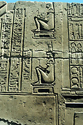Woman in birthing chair; various medical instruments on right. Limestone relief Kawm Umbu (Kom Ombo).