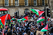 """London, United Kingdom, May 11, 2021: Pro-Palestinian demonstrators holding banners and Palestinian flags gathered outside Downing Street to protest against Israeli air raids on Gaza Strip. Demonstrators chanted """"Free-Free Palestine!"""" demanding the commitment of Great Britain to end their support for Israel. (Photo by Vudi Xhymshiti/VXP)"""