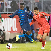 EAST HARTFORD, CONNECTICUT- October 16th: Tim Weah #11 of the United States is fouled by Alexander Callens #5 of Peru during the United States Vs Peru International Friendly soccer match at Pratt & Whitney Stadium, Rentschler Field on October 16th 2018 in East Hartford, Connecticut. (Photo by Tim Clayton/Corbis via Getty Images)