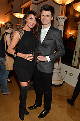 LIZZIE CUNDY and her son JOSH CUNDY at a party to celebrate the publication of  'I Used to be in Pictures' an untold story of Hollywood by Austin Mutti-Mewse and Howard Mutti-Mewse held at The Lansdowne Club, London on 6th March 2014.