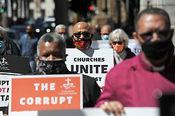 """South Africa - Cape Town - 15 September 2020 - Western Cape church leaders engaged in a public """"silent performance"""" against COVID-19 corruption outside St Georges Cathedral, Wale Street, Cape Town, from 12 midday on Tuesday, September 15. The event is part of a nation-wide campaign against corruption organised during September, Heritage Month, by the South African Council of Churches, under the banner """"Corruption is not our heritage"""". Photographer: Armand Hough/African News Agency(ANA)"""