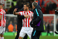 Marko Arnautovic of Stoke City is not happy about something at the final whistle and is pulled away ,Barclays Premier league match, Stoke city v Manchester city at the Britannia Stadium in Stoke on Trent, Staffs on Saturday 5th December 2015.<br /> pic by Chris Stading, Andrew Orchard sports photography.