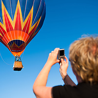 Viewer takes a photo of a balloon during the Velence Lake International Hot Air Balloon Festival in Agard, Slovakia on September 10, 2011. ATTILA VOLGYI