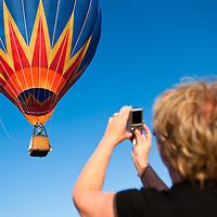 Viewer takes a photo of a balloon during the Velence Lake International Hot Air Balloon Festival in Agard, Slovakia on September 10, 2011. ATTILA VOLGYI