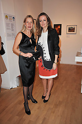 Left to right, IWONA BLAZWICK director of the Whitechapel Gallery and LUCY YEOMANS at the TOD'S Art Plus Drama Party at the Whitechapel Gallery, London on 24th March 2011.
