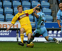 Photo: Pete Lorence.<br />Coventry City v Burnley. Coca Cola Championship. 09/12/2006.<br />James O'Connor slides in on Colin Cameron.