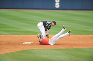 Ole Miss' Tanner Mathis (12) is caught stealing vs. Lipscomb Noah Chandler at Oxford-University Stadium in Oxford, Miss. on Sunday, March 10, 2013. Ole Miss won 9-8. The Rebels improve to 16-1.