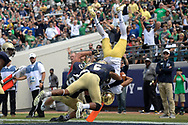 Notre Dame wide receiver Equanimeous St. Brown (6) flips over Navy linebacker Hudson Sullivan (53) and safety Sean Williams (6) for a 13-yard touchdown reception during the second half of an NCAA college football game in Jacksonville, Fla., Saturday, Nov. 5, 2016. Navy won 28-27. (Phelan M. Ebenhack via AP)