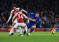 Football - 2018 / 2019 Premier League - Arsenal vs. Chelsea<br /> <br /> Eden Hazard (Chelsea FC)  gets held back by GranitXhaka (Arsenal FC) at The Emirates.<br /> <br /> COLORSPORT/DANIEL BEARHAM