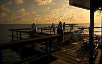 A group of people fishing in Lauderdale by the Sea Pier, in Fort Lauderdale, Florida.