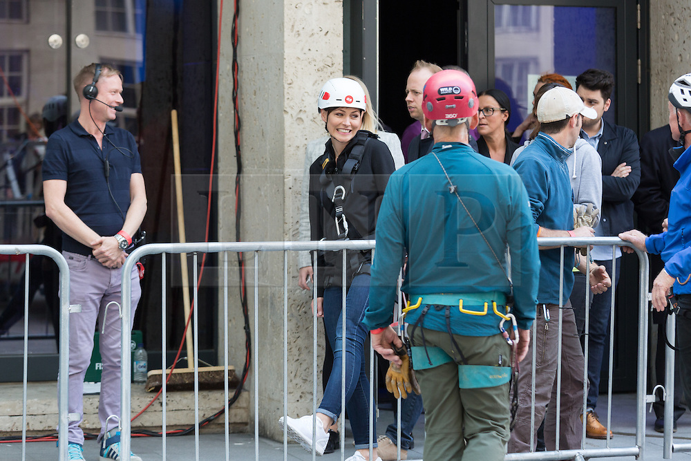 """© Licensed to London News Pictures. 10/06/2015. London, UK. Emma Willis prepares to take part in a """"leap of faith"""" stunt at the new BBC Broadcasting House. Photo credit : Vickie Flores/LNP"""