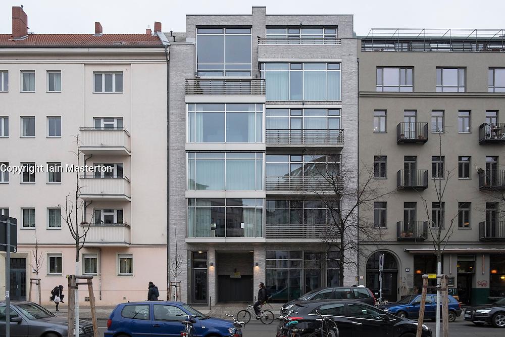Gentrification of Prenzlauer Berg district in Berlin, new luxury apartment block built between existing buildings in Berlin , Germany