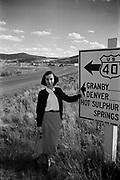 Octavia Hirschman by historic US 40 sign, Colorado, September, 1949.