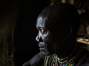 Mokoa looking at the issue of National Geographic with his picture in it. The Hadza camp of Senkele.