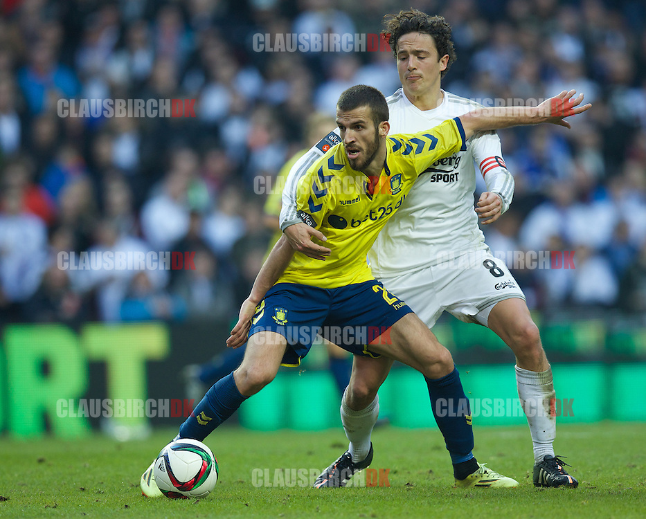 Ferhan Hasani of Brøndby IF is challenged by Thomas Delaney of FC København during the Danish Alka Superliga match between FC København and Brøndby IF at Telia Parken on March 8, 2015 in Copenhagen, Denmark. (Photo by Claus Birch)