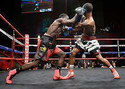 October 20, 2018 - Mashantucket, CT, U.S. - MASHANTUCKET, CT - OCTOBER 20: Sharad Collier  (blue gloves) takes on Derrick Whitley Jr. (grey gloves) in a Welterweight bout on October 20, 2018, at the Foxwoods Casino in Mashantucket, CT. Derrick Whitley Jr. and Sharad Collier ends via draw.  (Photo by Williams Paul/Icon Sportswire) (Credit Image: © Williams Paul/Icon SMI via ZUMA Press)