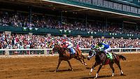 Horse racing on the dirt track  at Keeneland Racecourse, Lexington, Kentucky USA.
