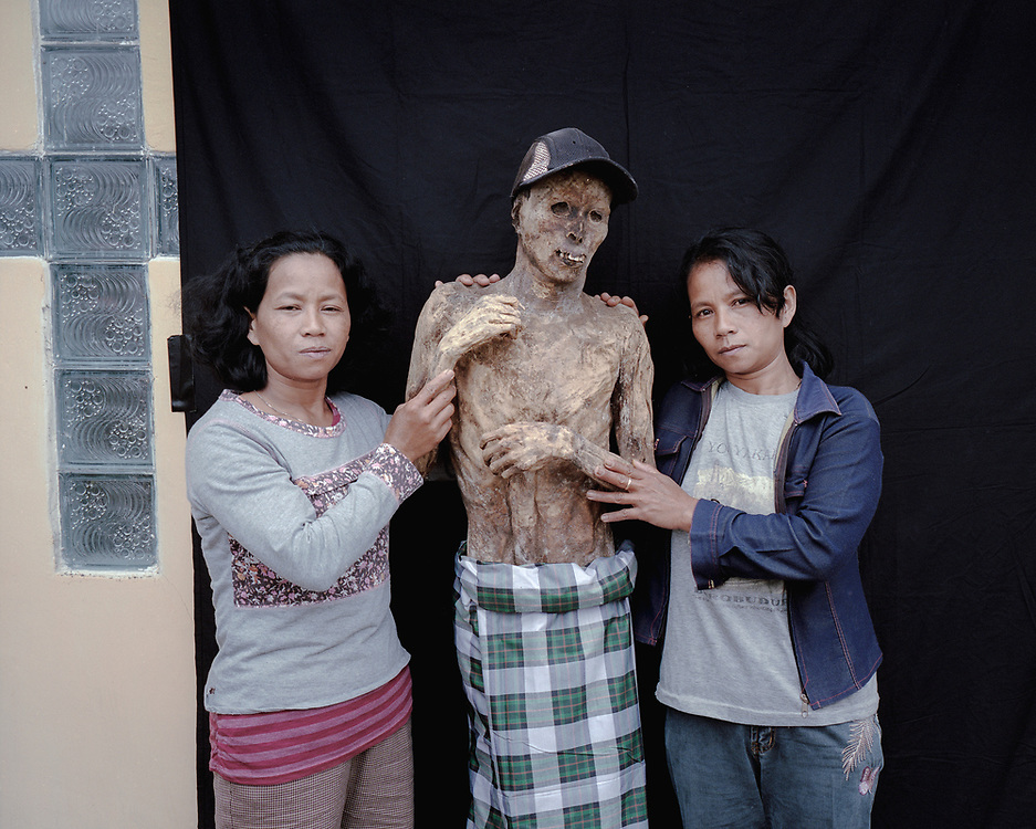 Twin sisters, Naomi and Ruth Sambara (39), with their father, Anton Sambara, who died 20 years ago.<br /> <br /> Ma'nene is a tradition that takes place in August after harvest where the bodies of the dead loved ones are exhumed to be cleaned, groomed and dressed. For most, it's a bittersweet moment, a chance to reunite and physically see and touch and reconnect with loved ones who had passed on.