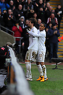 Swansea city's Michu celebrates with Jonathan de Guzman after he scores his sides 4th goal (his 2nd) . Barclays Premier league, Swansea city v Queens Park Rangers at the Liberty Stadium in Swansea, South Wales on Saturday  9th Feb 2013. pic by Andrew Orchard, Andrew Orchard sports photography,