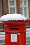 Snow-covered postbox in Hampstead , London, England, United Kingdom